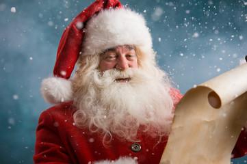 Santa Claus reading Christmas letter