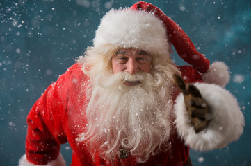 Santa Claus running outdoors at North Pole