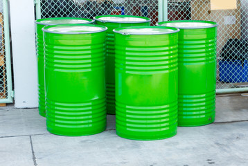 Green oil drums on an industrial site