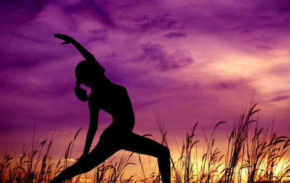 Silhouette woman yoga at outdoor park.