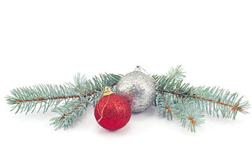 Christmas balls and pine needles isolated on white