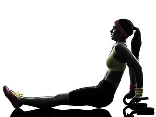 Wall Mural - woman exercising fitness push ups with holders silhouette