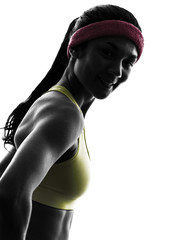 Wall Mural - woman exercising fitness workout  silhouette smiling portrait