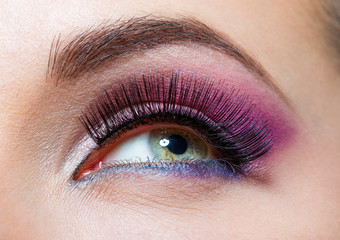 Close up of female eye with brilliant pink makeup