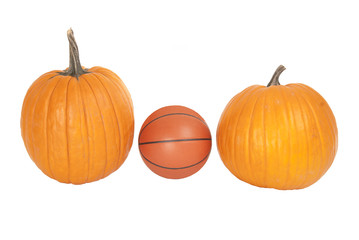 A leather basketball between two pumpkins fall harvest halloween