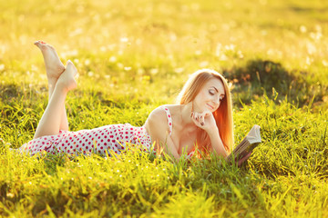 Young pretty woman reading book.