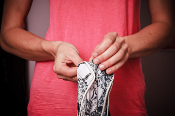 Young woman mending her clothes at home