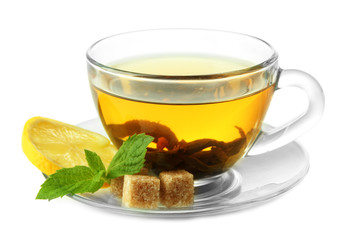 Transparent cup of green tea with lemon and mint isolated