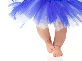 baby girl like a ballet dancer in blue tutu, isolated on white