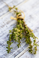 Thyme herbs on the wooden table