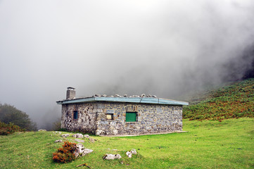 Wall Mural - shelter in the mountain with fog