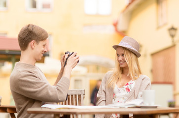 couple taking photo picture in cafe