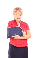 Injured mature woman with broken arm looking at camera