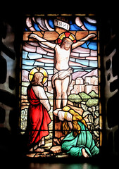 Colorful window with the image of the crucified Jesus