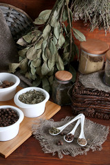 Assortment of spices in  white spoons and bowls,