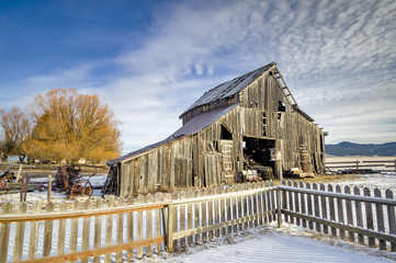 Rustic old weathered barn in the winter