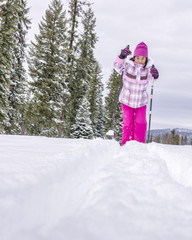 Young asian girl skiies in winter