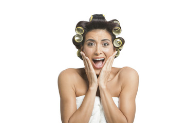 Woman screaming with curlers in hair