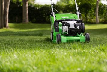 Green lawnmower on green lawn