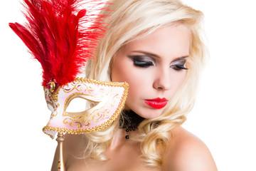 verführerische junge Frau mit Stabmaske