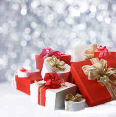 Christmas gifts against sparkling party lights