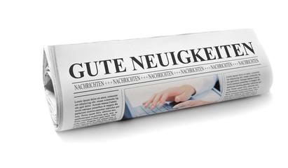 Zeitung mit guten Neuigkeiten