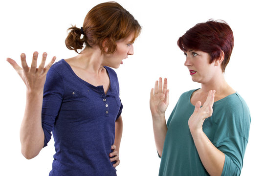 two Caucasian women arguing and distrusting each other