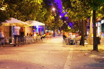 Pedestrian street in  mediterranean town at night