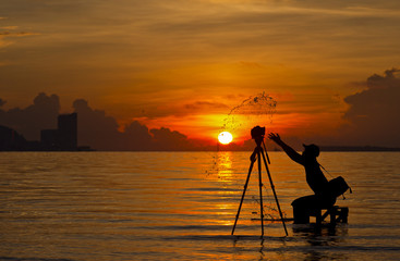 A silhouette of  photographer