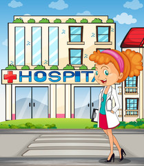 A pretty doctor standing in front of the hospital