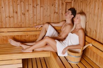 Young couple enjoying sauna