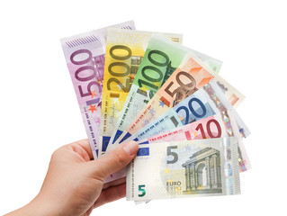 euro banknotes in hand on white