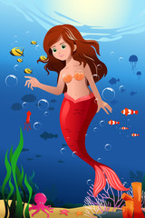 Little mermaid in the ocean