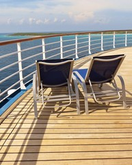 Lounge chairs on a cruise ship deck