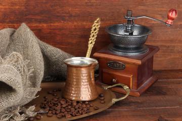 Fotobehang Koffiebonen Coffee grinder, turk and coffee beans