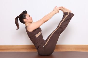 woman doing yoga exercise called vatjarolesana