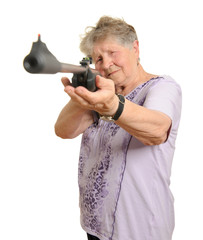 Senior woman with a rifle isolated on white