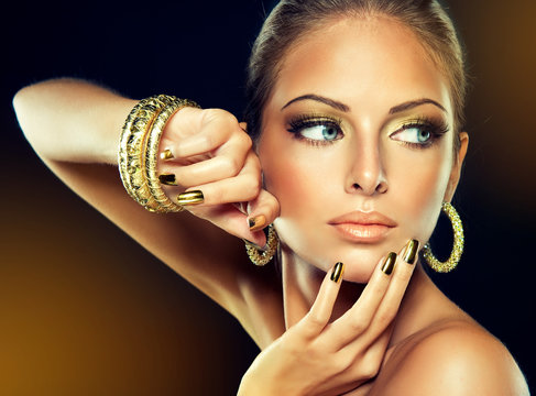 The girl with the Golden makeup and metal nails.