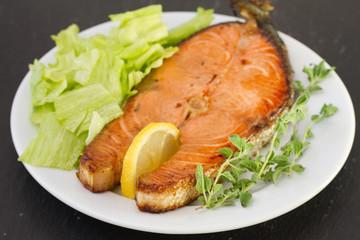 fried salmon with lemon and salad