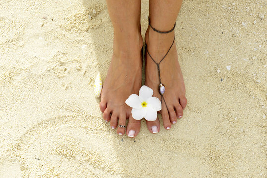 Woman feet in the sand