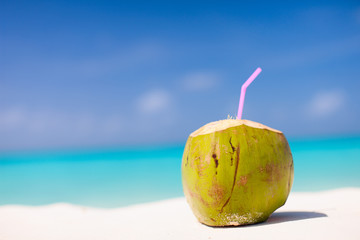 Coconut on a tropical beach Wall mural