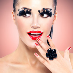 Face of beautiful fashion woman with red sexy lips