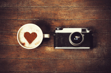 Cup of coffee with retro camera