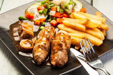 Beef rolls with french fries