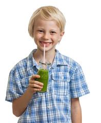 Cute boy drinking green smoothie