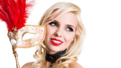 attraktive junge Frau mit venezianischer Stabmaske