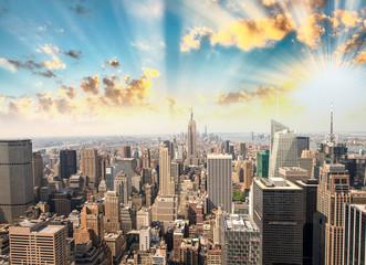 Stunning sunset in New York. Aerial view of Manhattan skyline an