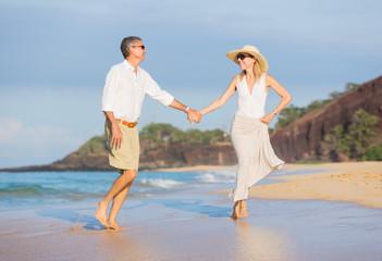 Middle Aged Couple Enjoying Walk on the Beach