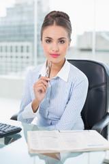 Content brunette businesswoman holding glasses
