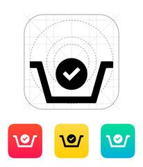 Shopping basket check icon.